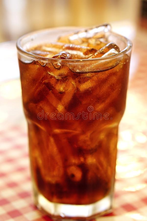 Cola in drinking glass with ice. stock photo