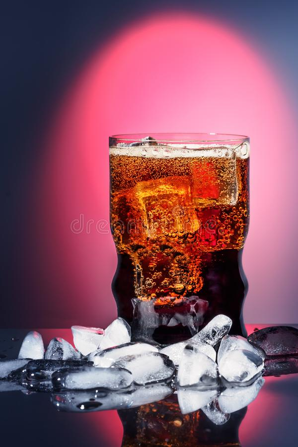Cola in drinking glass with ice sweet sparkling carbonated drink beverage fast food with big calorie stock image