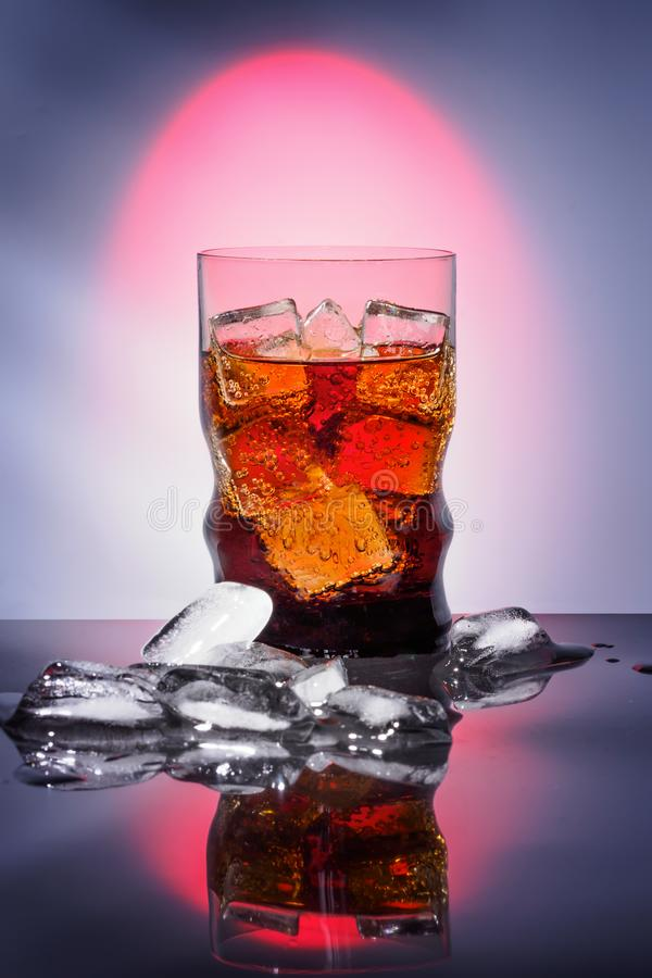 Cola in drinking glass with ice sweet sparkling carbonated drink beverage fast food with big calorie royalty free stock photography