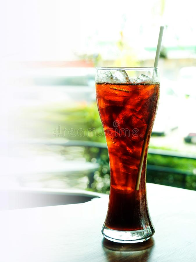 Cola in glass with cool ice for stop hungery eagerly. Concept of stop hot stock photography