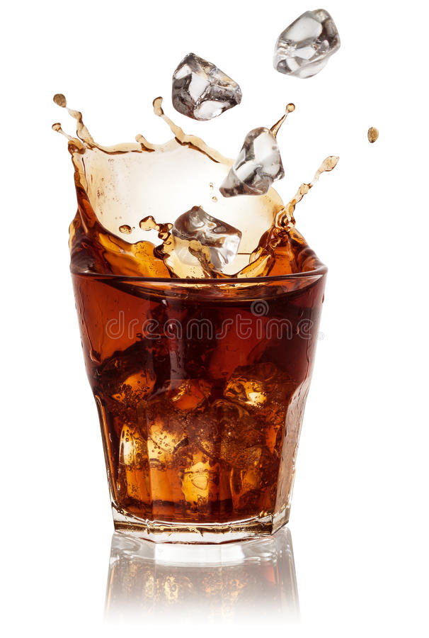Cola glass with falling ice cubes on white. With clipping path. Cola glass with falling ice cubes over white. With clipping path stock photo