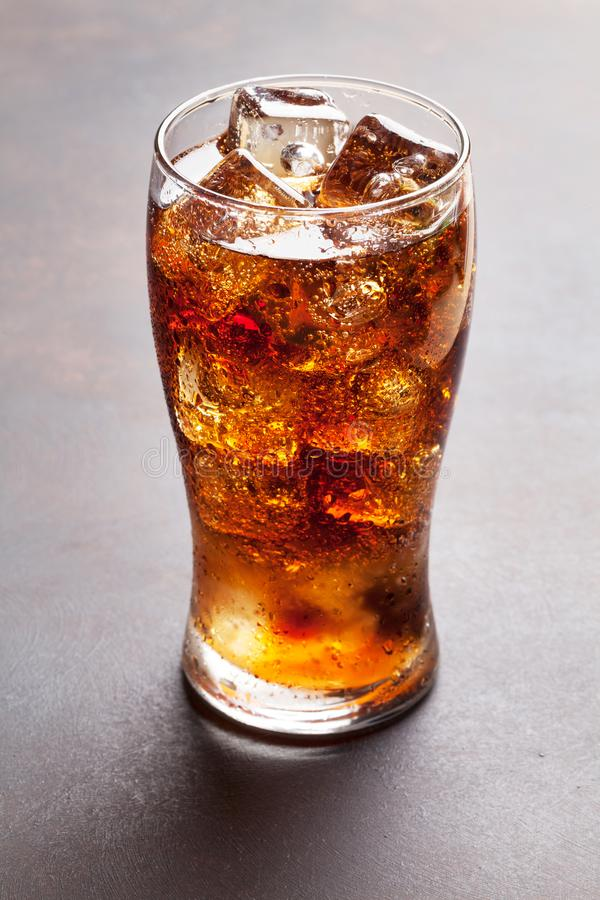 Cola glass with ice. Cubes stock photos