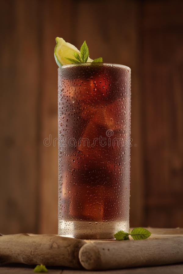 Glass of cola with ice. royalty free stock image