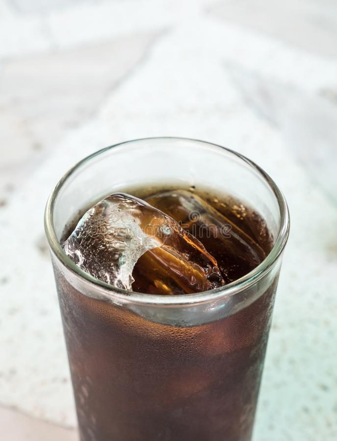 Cola with ice cube in the glass. stock images