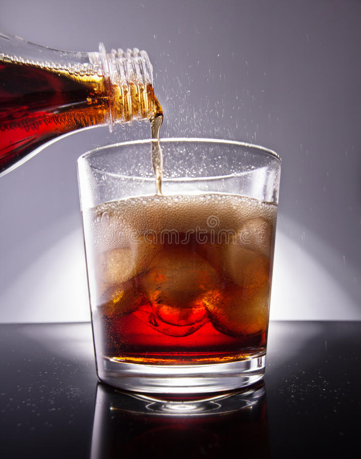 Cola with ice cubes royalty free stock photography