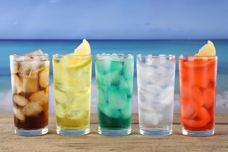 Cola and lemonade soda drinks on the beach. Cola and lemonade soda or soft drinks on the beach royalty free stock images