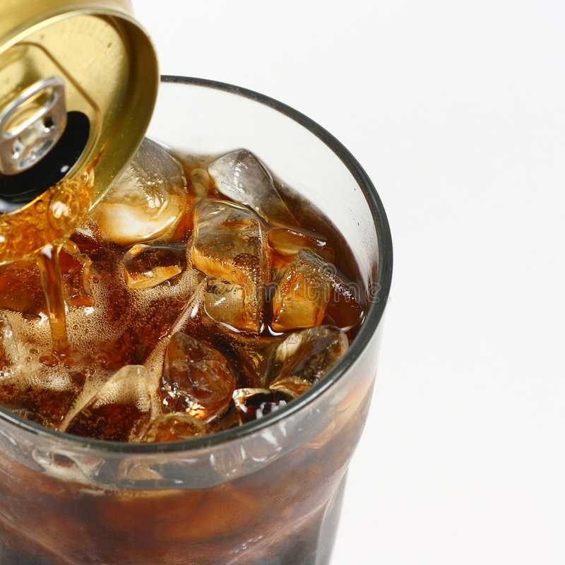 Cola Pouring From A Can royalty free stock photo