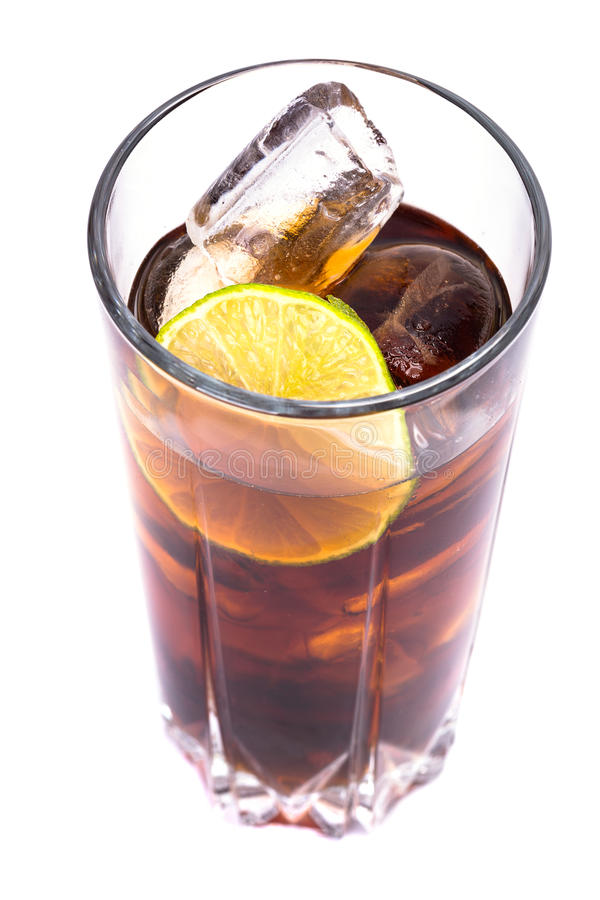 Cola in tall glass with ice cubes and lime