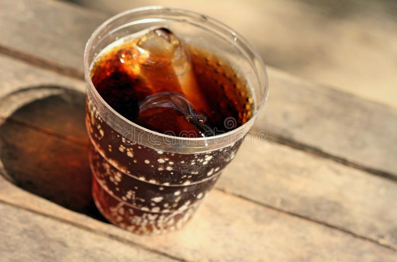 Cola on wooden royalty free stock photo