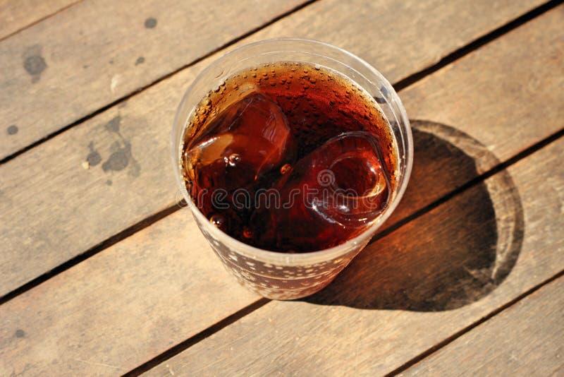 Cola on wooden stock photos