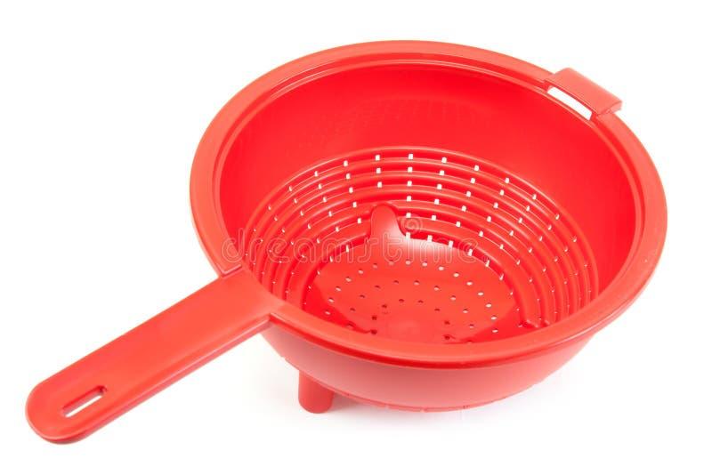 Colander plástico brilhante vermelho fotos de stock