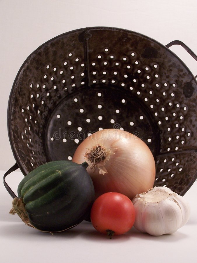 Colander and produce. royalty free stock photos