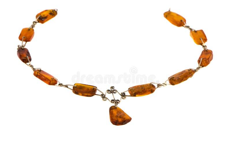 Colar ambarina da pedra da cor do ouro isolada no branco imagens de stock royalty free