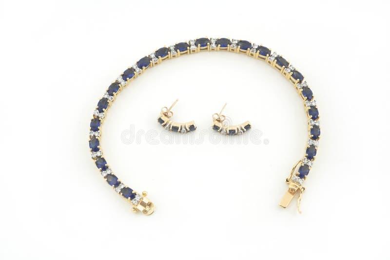 Colar e earings do ouro de Jewelery isolados imagem de stock