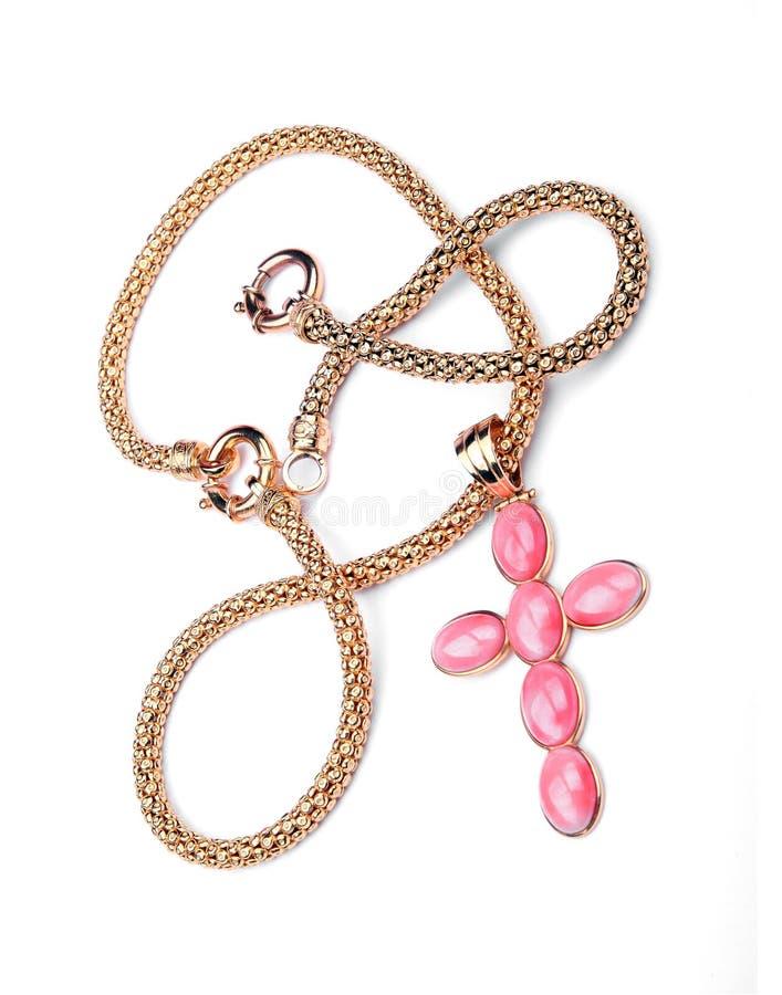 Colar transversal dourada com as gemas cor-de-rosa preciosas fotos de stock royalty free