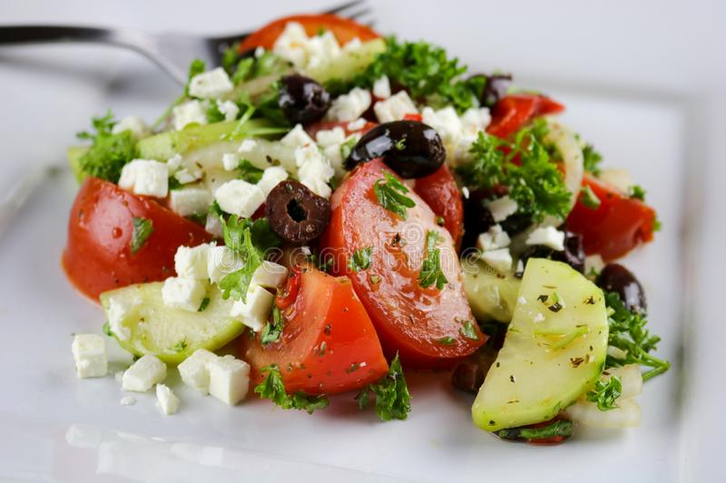 Home style Greek salad stock photography