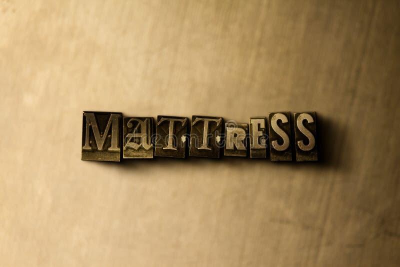 COLCHÃO - close-up vintage sujo da palavra typeset no contexto do metal imagem de stock royalty free