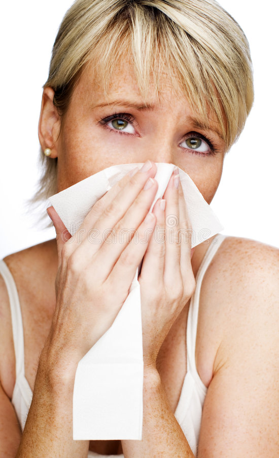 Cold. Young blond woman having a cold close up royalty free stock images