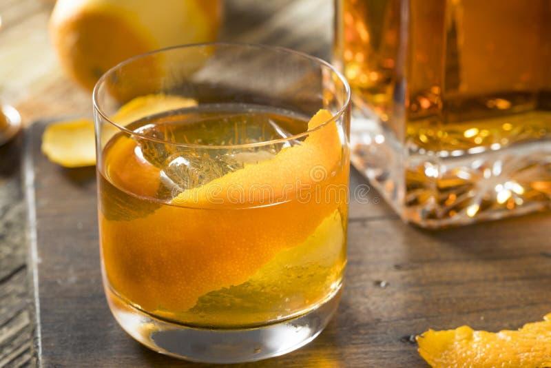 Cold Alcoholic Old Fashioned Bourbon Whiskey Cocktail. With Orange Garnish royalty free stock image