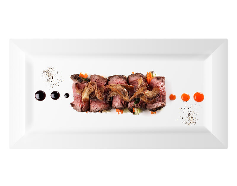 Cold appetizer of meat (white background) royalty free stock photos