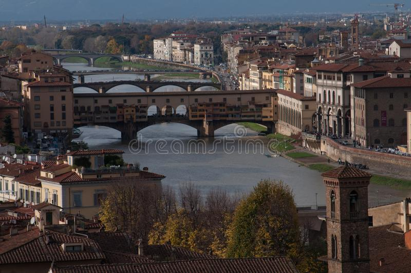 Ponte Vecchio on Arno river in Florence afternoon stock photos