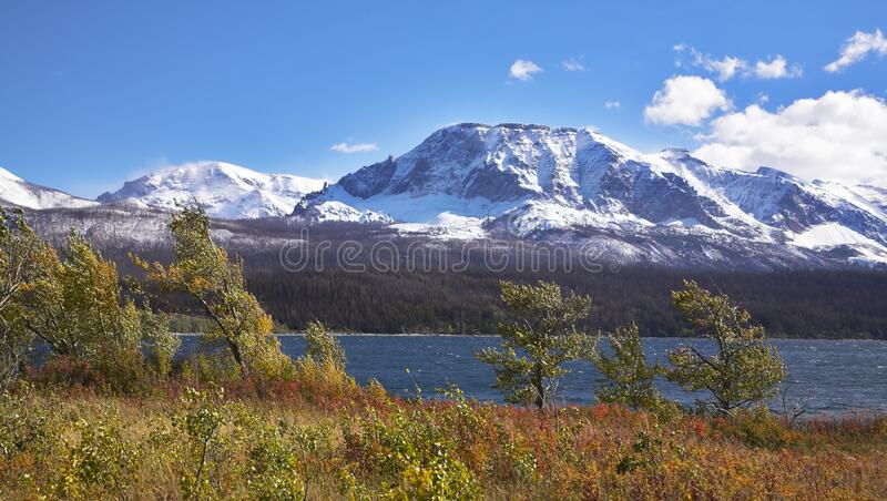 Cold autumn wind. Above deep lake with dark blue water royalty free stock photo