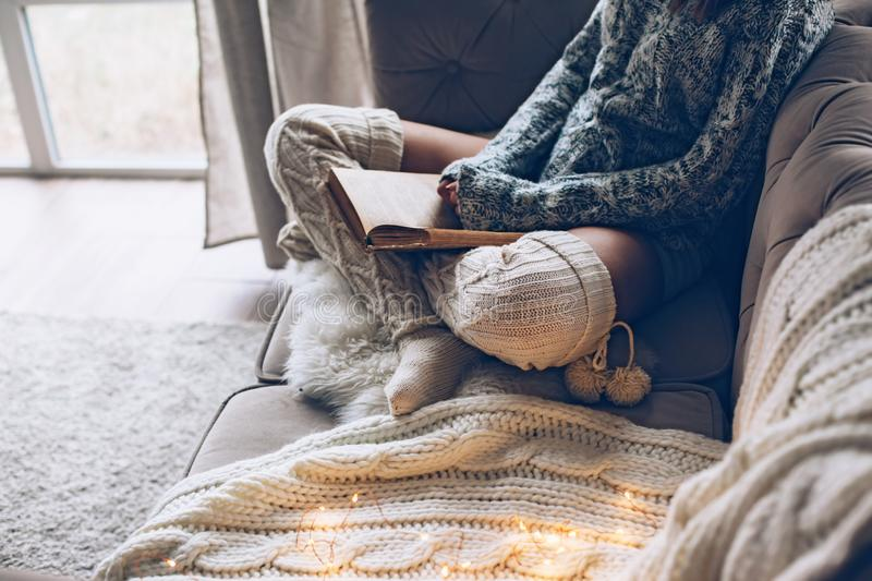 Girl reading and relaxing on a couch stock photo