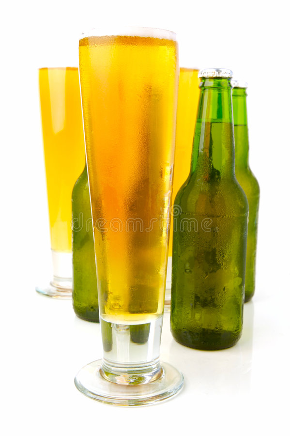 Cold Beer. Ice cold beers isolated against a white background royalty free stock images