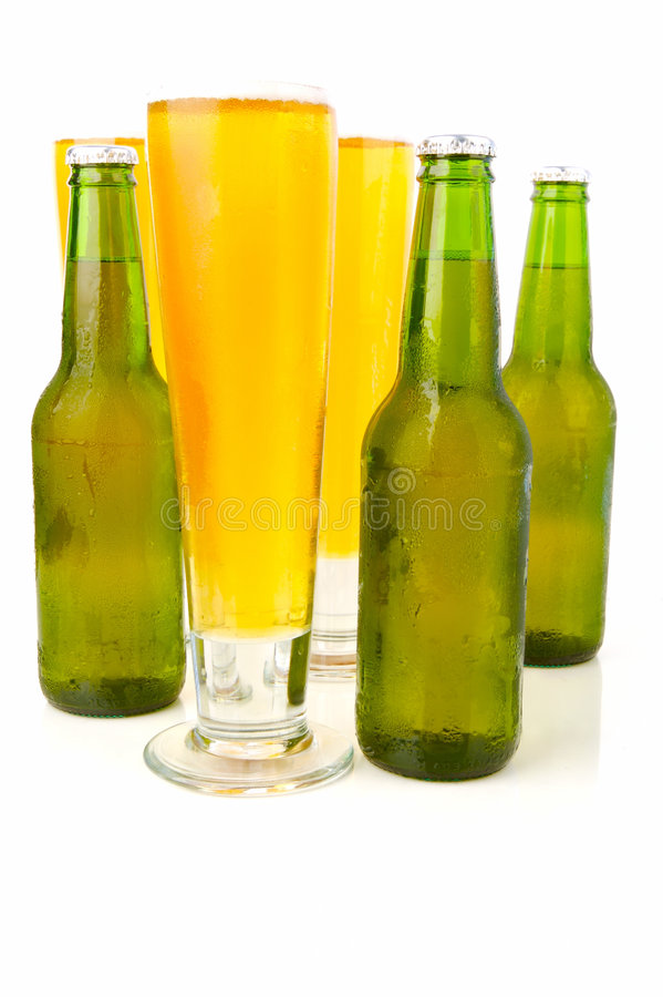 Cold Beer. Ice cold beers isolated against a white background royalty free stock photo