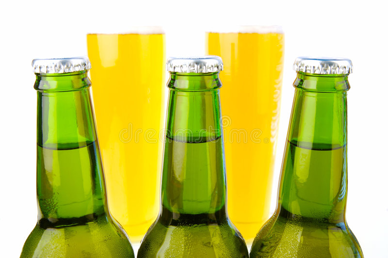 Cold Beer. Ice cold beers isolated against a white background stock image