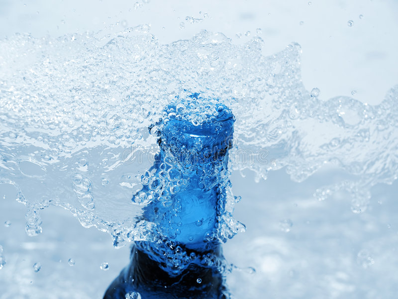 Cold beer bottle. In icy water stock image