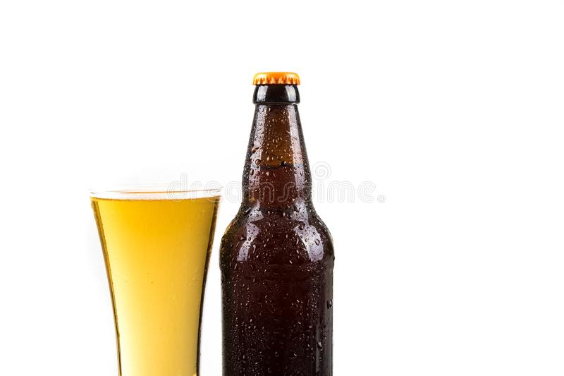 Cold beer. Bottle and glass with water droplets stock photography