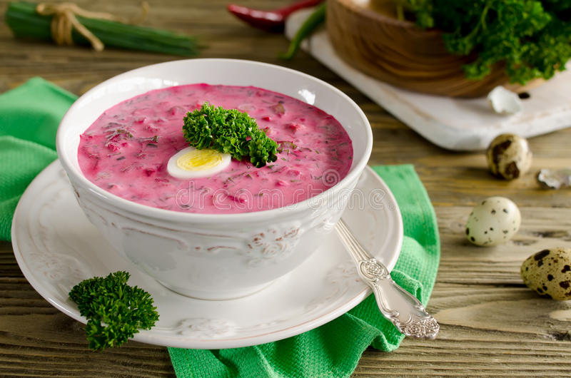 Cold beet soup with egg, cucumber, potatoes and greens stock photos