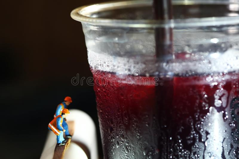 Cold beverage plastic cup scene. royalty free stock photography