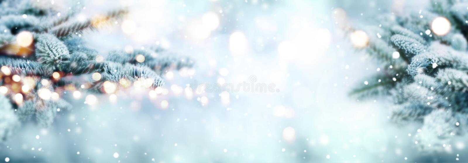 Cold blue snowy winter scenery. With bright bokeh for a christmas decoration royalty free stock photography