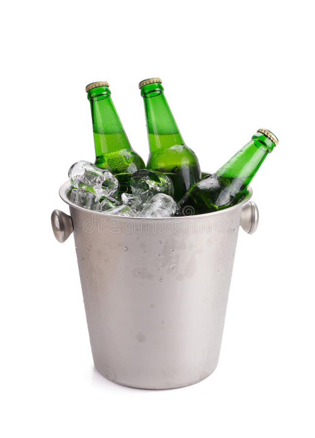 Cold bottles of beer in bucket with ice on white background. Cold bottles of beer in bucket with ice on white background stock photography