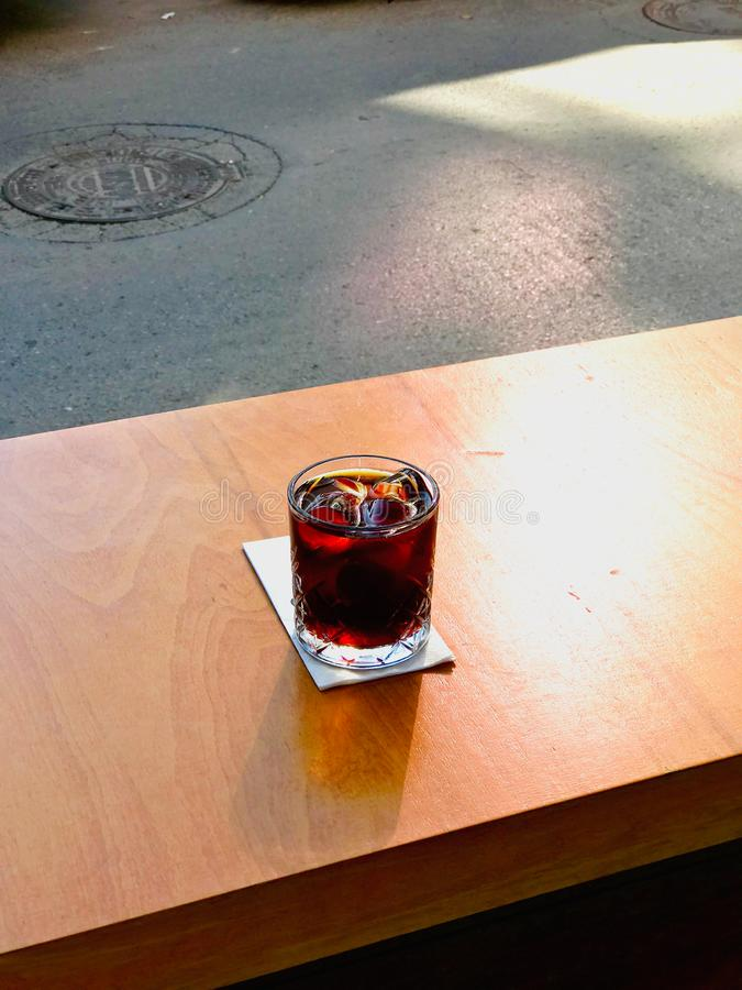 Cold Brew Coffee with Ice or Iced Coffee at Cafe Shop on Wooden Surface. Organic Beverage stock photo