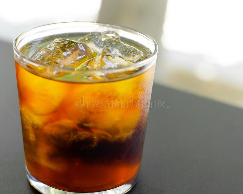 Cold brew coffee on the rock. In a whiskey style glass and blurry background royalty free stock image