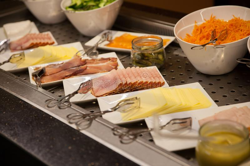 A cold buffet at breakfast in international hotel royalty free stock photography