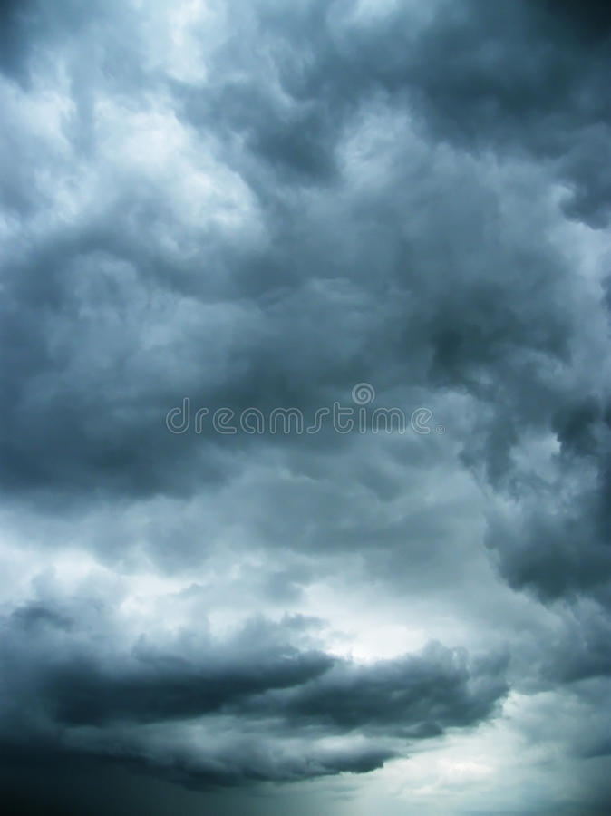 Cold clouds in the night sky. Darkly dark blue night sky, cold heavy clouds stock photo