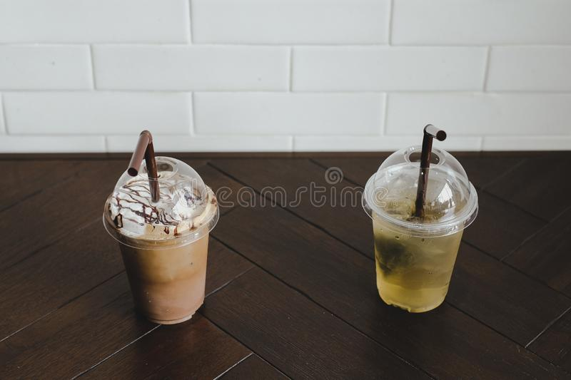 Cold coffee and Iced green tea on the wooden table. For relax in summer royalty free stock image