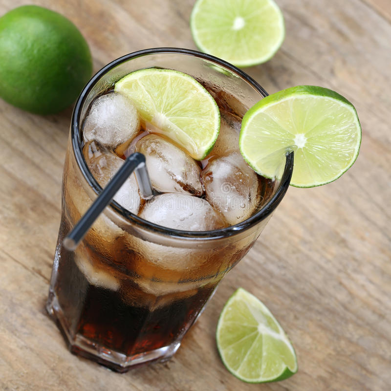 Cold Cola drink with limes. And ice cubes stock photos