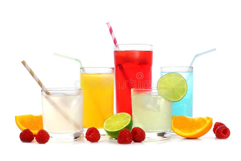 Cold colorful summer drinks with fruit isolated on white royalty free stock photo