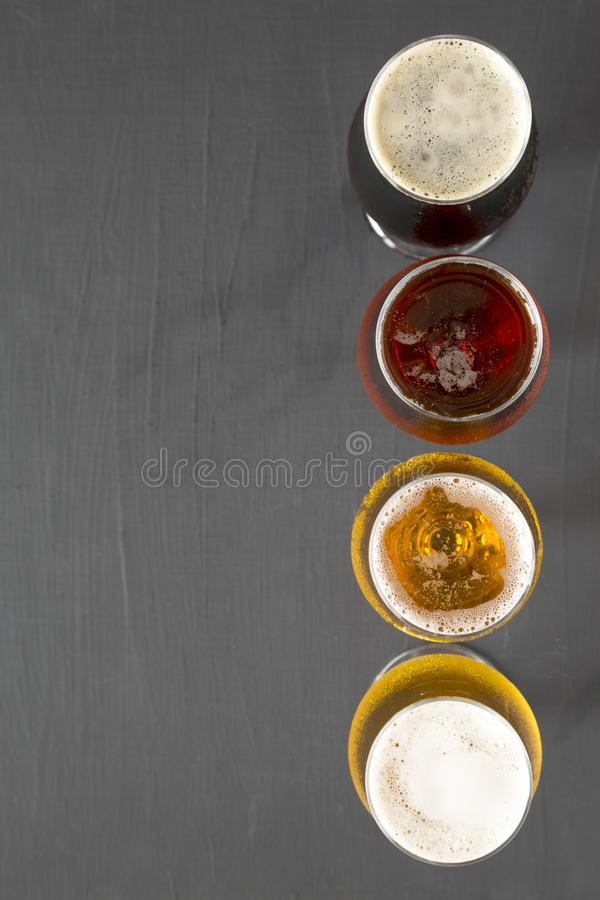 Cold craft beer assortment on a black background, top view. Copy space stock image