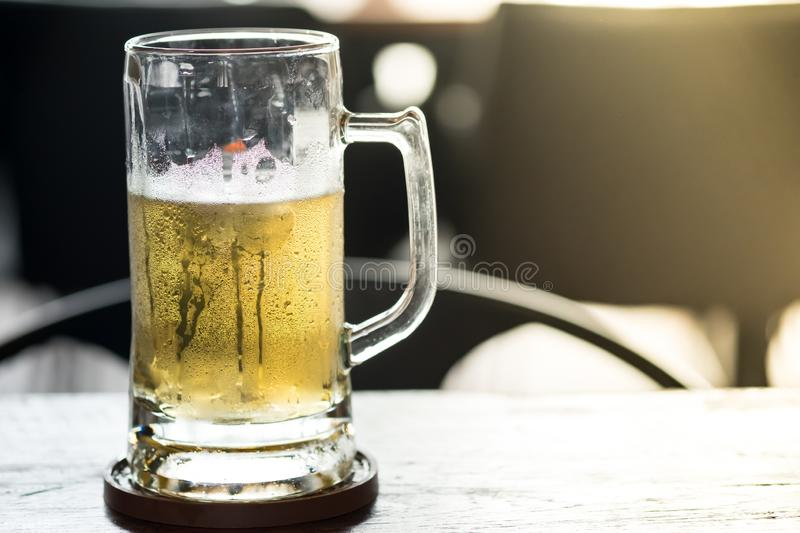 Cold craft light and dark Beer in a glass stock image