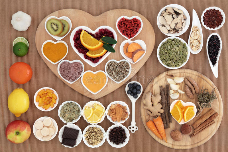 Cold Cure Food. Large health food for cold cure high in antioxidants and vitamin c with supplement capsules and medicinal herbs and spices royalty free stock photo