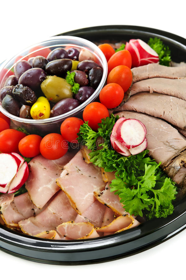 Cold cut platter. Isolated platter of assorted cold cut meat slices royalty free stock photography