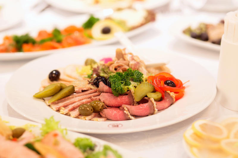 Download Cold Cuts Of Pork On The Serving Table. Meat Appetizer On A Plat Stock Photo - Image: 83711897
