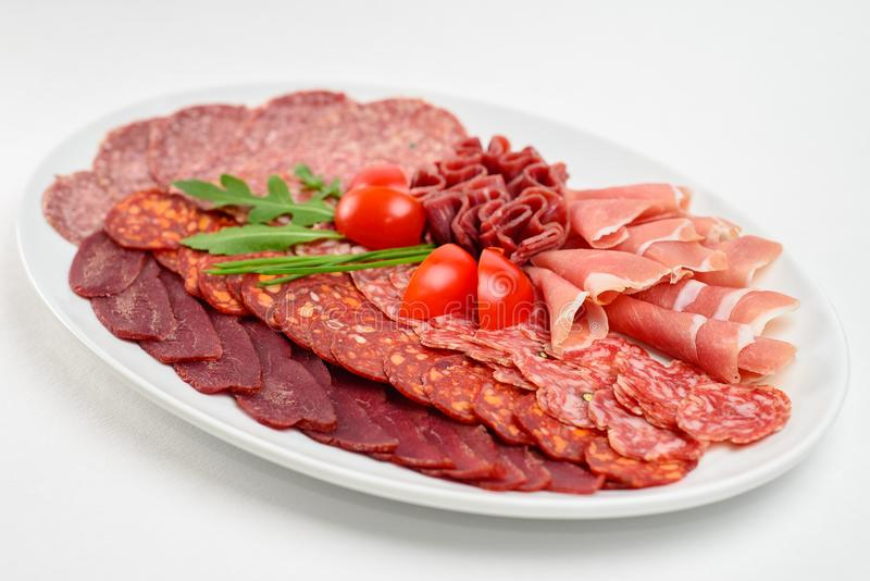 Cold cuts on a white plate royalty free stock photo