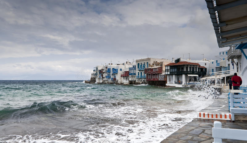 Cold day in Small Venice. Of Mykonos island with sea waves stock photo